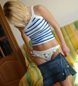 Shy Blonde Lifts her Skirt