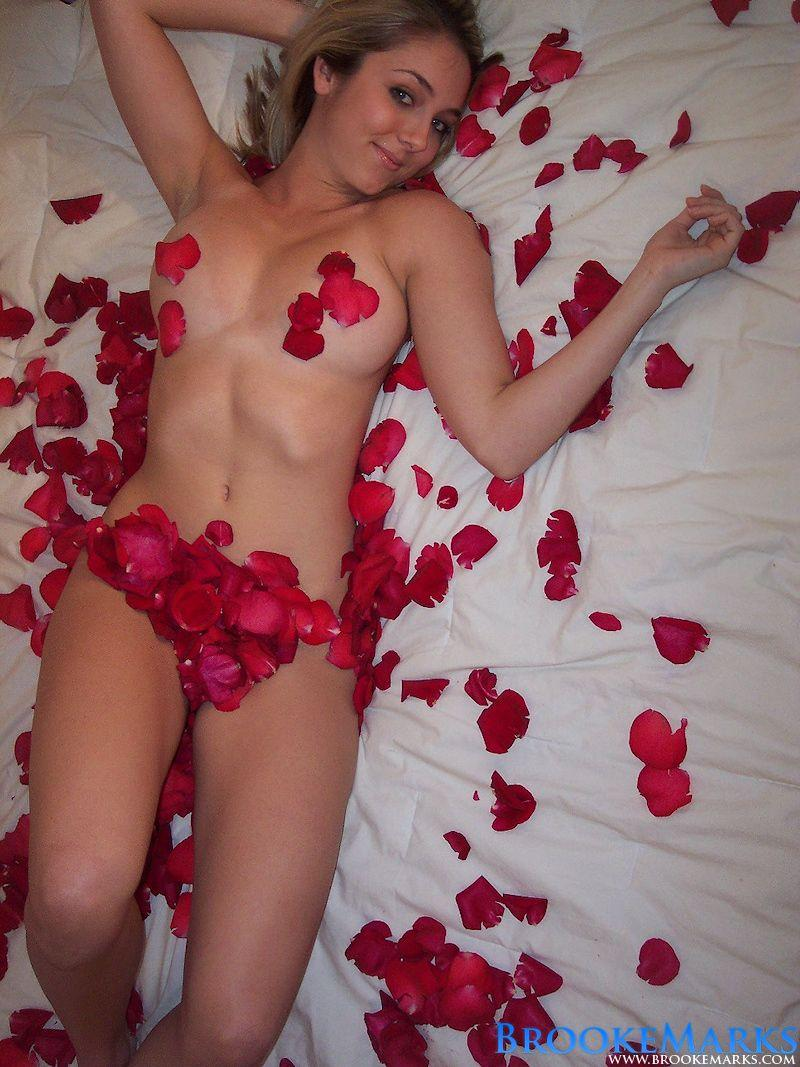 Bare breasted Brooke Marks covered in rose petals
