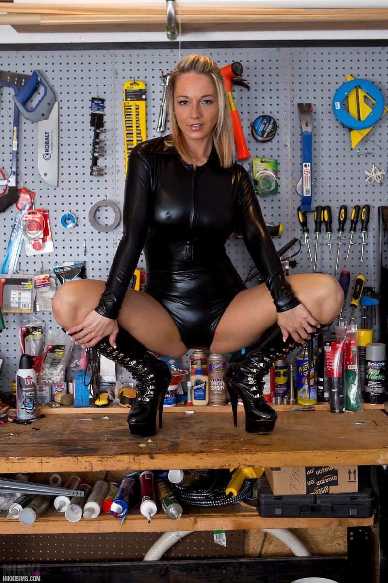 DIY expert girl Nikki Sims teasing in leather