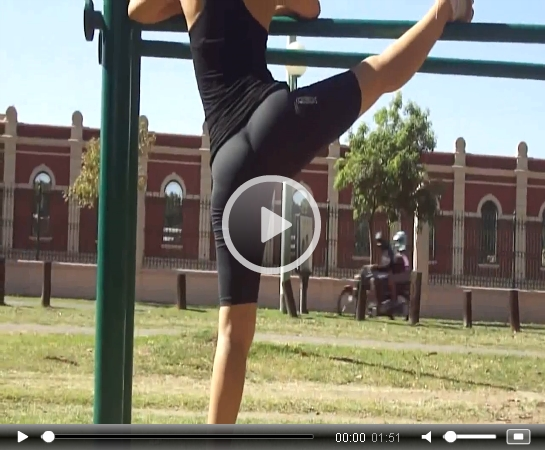 Fit Girl Stretching in the Park