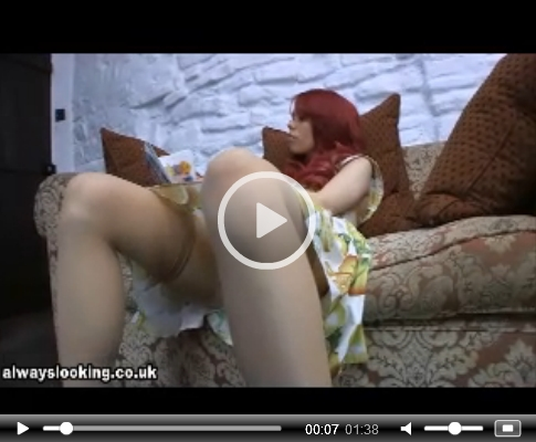 Girl Upskirted as she Reads on the Sofa