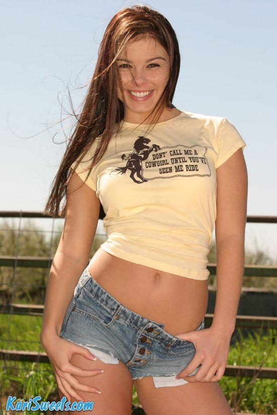 Kari Sweets smiling in blue denim shorts | Daily Girls @ Female Update