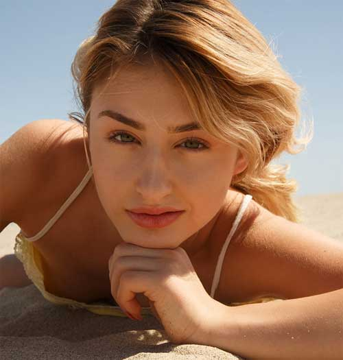 Ksenia Gali in blue denim shorts on the beach with | Daily Girls @ Female Update