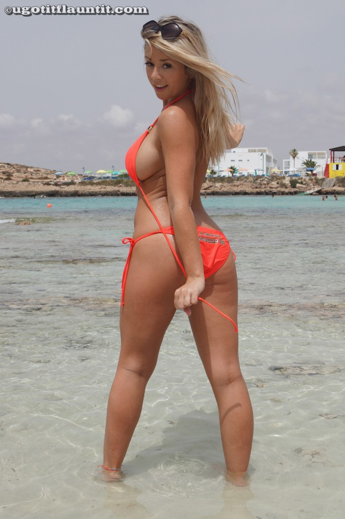 Mel Poses in an Orange Bikini for UGotItFlauntIt